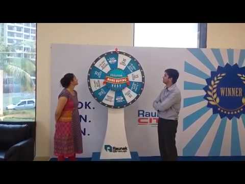 Mr and Mrs Vernekar spinning the Home Buying Fest wheel.